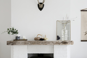 A detail of a modern farmhouse style fireplace.