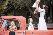 Ruthie Sommers with her three daughters in a vintage pickup truck