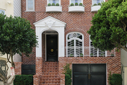 An 1867 brick San Francisco residence with high-gloss black lacquer doors