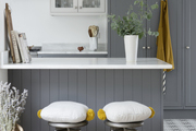 A pair of metal stools at a kitchen counter.