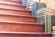 Stacks of books on a staircase