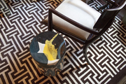 A black glass side table with a bright yellow streak
