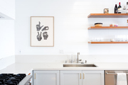 A white kitchen with open shelving.