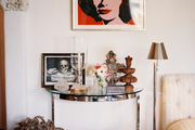 A Warhol piece hung above a chrome-and-glass end table