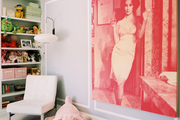 A large-scale pink-hued photograph of Elizabeth Taylor in a girl's nursery