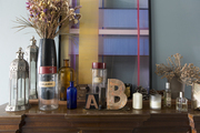 A decorative display of assorted objects on a wood table