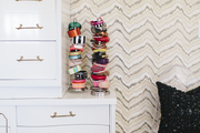 Movement and asymmetrical design are found in this wallpaper, dresser, and jewelry stack.