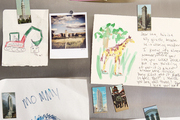 Drawings and magnets displayed on a fridge