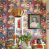 A room with bold, colorful floral wallpaper.