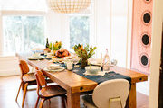 A contemporary dining table set for Thanksgiving dinner.