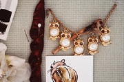 Jewelry and artwork pinned to an inspiration board