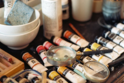 Art supplies and magnifying glasses arranged on a desk