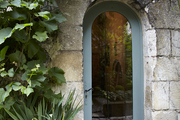Stone archway into french cottage.