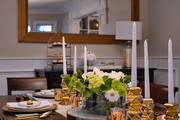 A transitional dining table with gold accents.