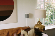 Detail shot of living room with leather sofa and vintage wall art.