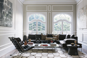 A living room with contemporary art, European-style windows, and B&B Italia's Charles sofa