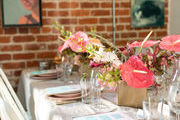 A neutral tablescape with pink flowers.