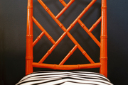 A red fretwork chair with zebra-print upholstery