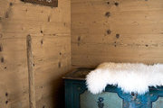 Chest with sheepskin throw and antique mallet
