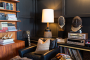 Bookshelves, vintage records and audio equipment, and old fencing masks at Hammer and Spear's downtown LA loft