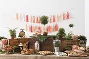 A spring woodland–themed table at Brooklyn's Curious Jane included a crowd-pleasing brunch spread from Runner & Stone. Props and products from Octavia & Brown, Serene Spaces Living, and NY Topiary, among others.