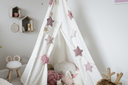 A white teepee in a contemporary kid's room.