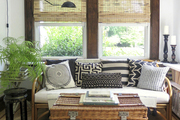 Bohemian Safari style living room with zebra print rug.