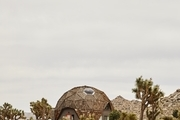 A dome house in the desert.