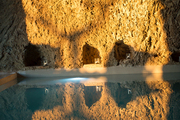 A pool set in a cave