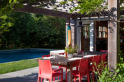 An outdoor dining area beside a pool