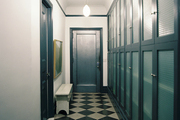 Checkered flooring in a hallway lined with cabinets