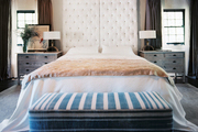 A serene master bedroom with a white tufted headboard