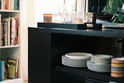 A dining sideboard filled with dishes and entertaining essentials
