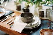 Slate trays used as place mats on a wooden table