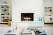 A simply styled white fireplace