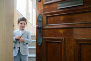 A young host greets visitors to a Bastille Day dinner party