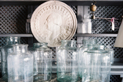 Glass jars on a marble-topped cabinet