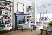 Blue fireplace in vibrant living room.