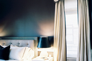 A black-and-white color scheme in a bedroom with a tufted headboard