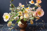 A loose, organic bouquet of pink and peach flowers.