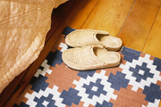 A pair of shoes atop a patterned rug