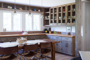 A dining table in an open kitchen