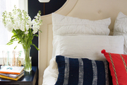 Contemporary navy blue bedroom with white and beige accents.