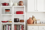 A white kitchen with white shelving.