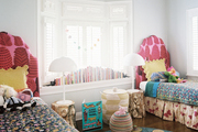 Matching twin beds covered by a mix of patterns