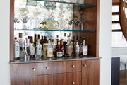 Brown wood midcentury style bar shelf.