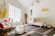 An eclectic kid's room with yellow accents.
