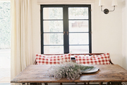 A breakfast nook with a rustic wood table