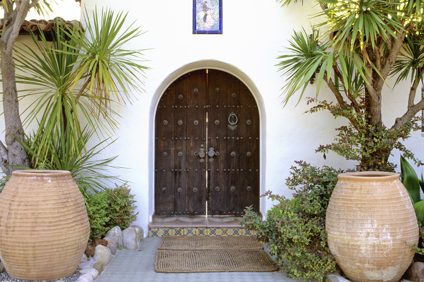931 #4F5E28 Stick With Your Style 15 Ways To Improve Your Curb Appeal Lonny image Mediterranean Style Entry Doors 39631400
