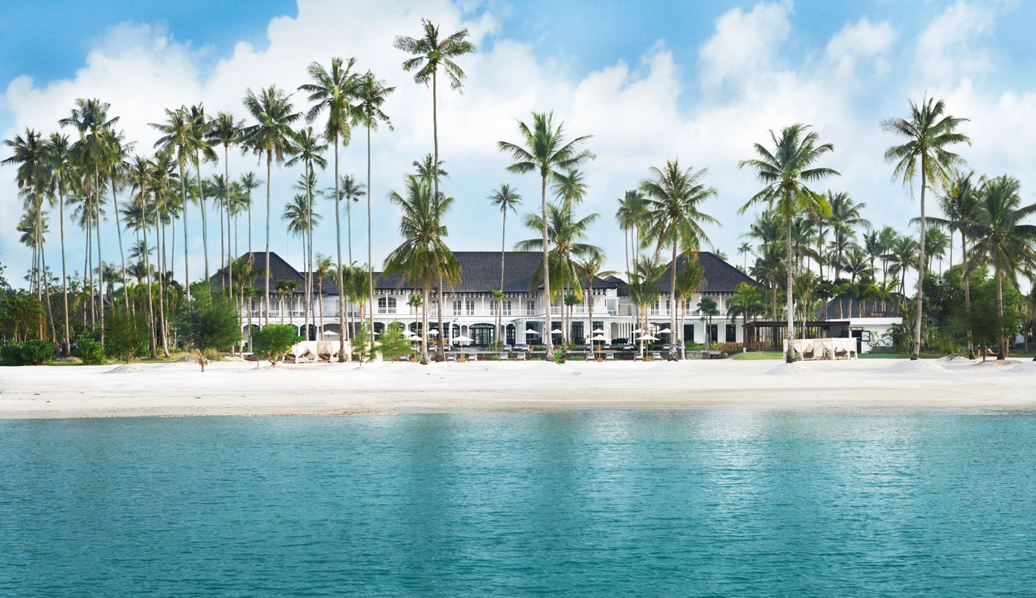 Set in a coconut grove on the Indonesian island of Bintan, the colonial-style Sanchaya resort overlooks cerulean seas and a white-sand shore.